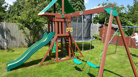 Swings and slide wooden playarea + playhouse