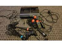 Ps3 80gb buzz controllers , one Sony controler, sing star microphones, guitar hero Mic, a