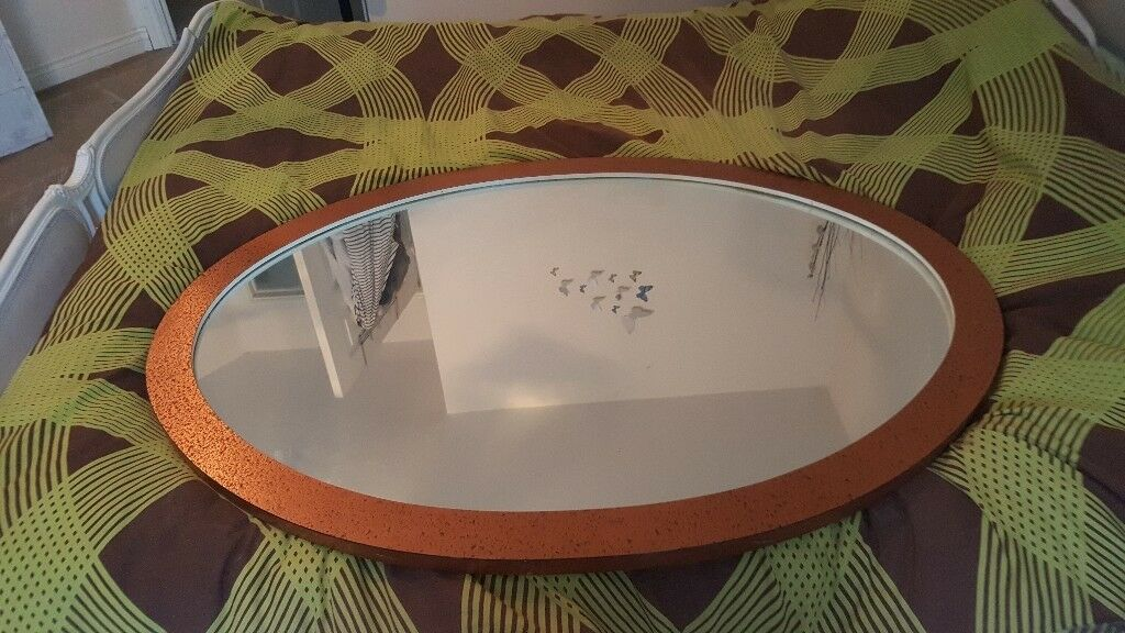 Large solid heavy framed mirror