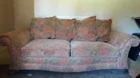 Three seater sofa multi coloured good condition 970mm x 2000mm.