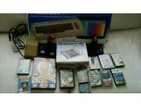 Comador 64 all boxed 2 joy sticks and 13 games