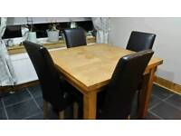Solid oak table and 4 leather style chairs