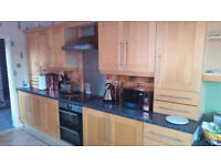 Complete Shaker style light wood kitchen