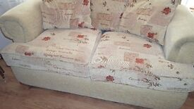 For sale two seater settee in cream.