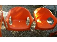 Two contemporary orange carver chairs
