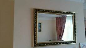 Pretty detailed framed mirror.
