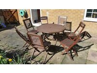8 PIECE GARDEN SET, WOODEN GARDEN TABLE AND 7 CHAIRS