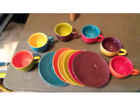 Brightly Coloured coloured cups and saucers in good condition.