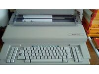 OLIVETTI ELECTRONIC TYPEWRITER WITH REPLACEMENT CARTRIDGES