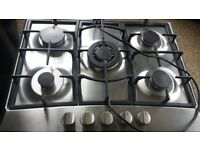 70 cm 5 ring gas hob. Auto ignition. Cast iron pan stands.