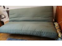 Futon double sofa bed fold down instantly with click-down mechanism, storage space