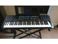 Portable Keyboard in great conditions, 61 Keys, good for students and experts musician, with stand