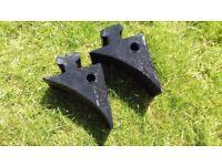 A pair of heavyweight black rubber wheel chocks