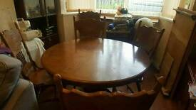 Pedestal table seats upto 6 people excellent condition with 6 carver chairs