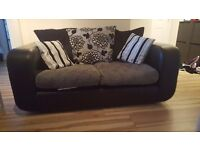 2 seater sofa, black leather with grey material, good condition.