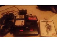 Sega megadrive 2 with 2 controllers and 4 games
