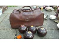 Set of 4 Henselite 4 7/8ths crown green bowls, leather carry bag and measure
