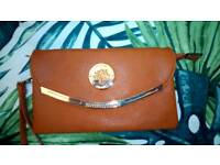 Mulberry brown leather wristlet bag