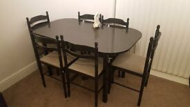 Dining table and 6 chairs. Free to a good home