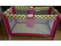 Babylo pink and green travel cot.