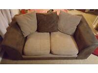 2 seater sofa. Slight damage to cushion cover