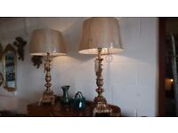 Pair of tall ornate lamps and shades.