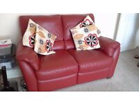 red leather 2 seater sofa with lazy boy foot rest.