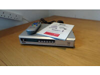 Tevion Satellite receiver box with instructions and remote