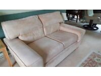 Suede Effect Beige Sofa and matching footstool with storage. Never been out of the cover.