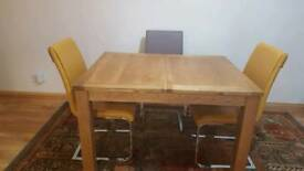 Extendable Wood dining table with 3 brand new chairs