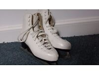 Ladies size 4 ice skates with bag