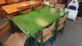 Pine extendable dining table painted green with 6 chairs
