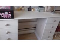 Solid white wooden chest of drawers and white wooden dressing table to match