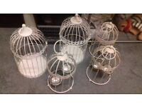 Selection of birdcage tealight lanterns, wedding decorations