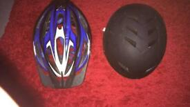 1 adult bike helmet and 1 bmx helmet