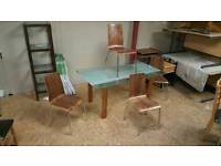Heavy smoked glass table with 4 walnut chairs