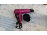 Hair dryer, ionic with removable concentrating nozzle, diffuser and cool shot function.