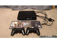 PS3 Slim 500GB with 2 controllers plus The Last of Us, GTA V, and Skyrim