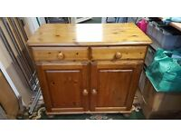 Two draw two door dining room cupboard.