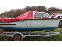 16ft fishing boat. Including 15hp mariner outboard engine and trailer.