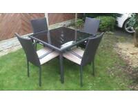 Brand new black rattan table and four chairs