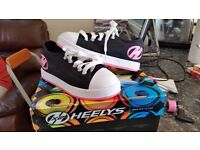 Black and Pink Heelys size 1 LIKE NEW
