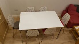 MODERN IKEA DINING TABLE with 6 chairs. Delivery possible.