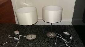 Lovely pair of table/bedside lamps. Chrome with ivory shades NEW