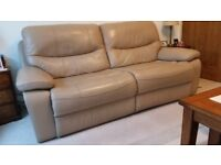 Two leather reclining Sofas and one chair, all seats with manual footrest.