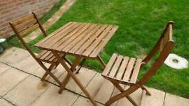 Folding Ikea patio table and 2 chairs