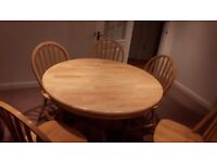 Extending oval table and six chairs in pine