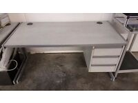 Great quality, excellent condition grey desks with integrated drawers. Chairs also available.