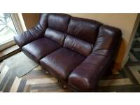 Two seater aubergine leather sofa