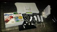 wii system  and wii fit for sale with 18 games.